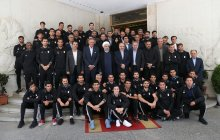 Meeting with national football team's coach, players, and coaching staff