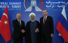 Presidents of Iran, Russia and Turkey pose for photos